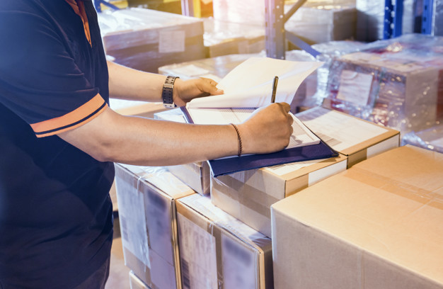 Warehouse worker are working in warehouse store with inventory the shipment. Premium Photo
